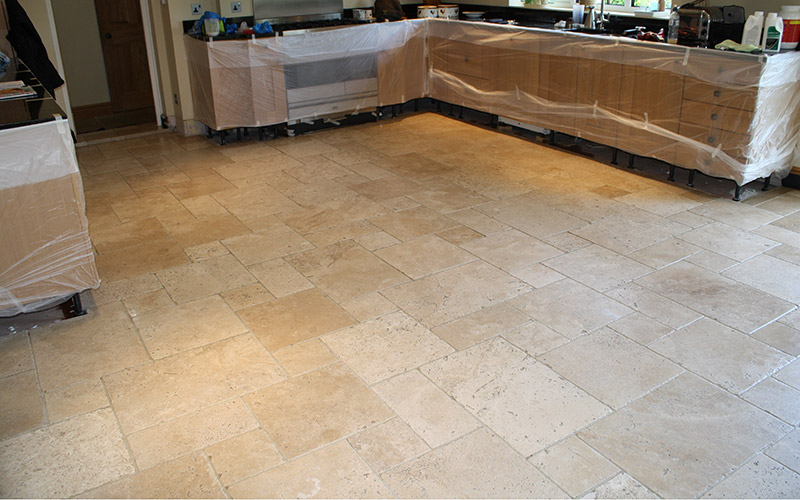 A beautiful travertine limestone kitchen floor after a maintenance clean and re-seal